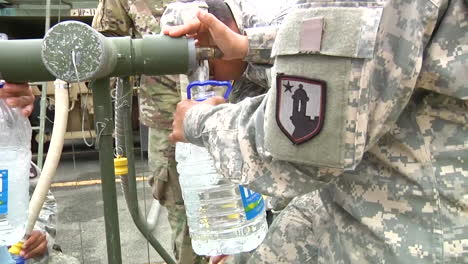 Water-And-Relief-Supplies-Are-Delivered-To-Victims-Of-Hurricane-Maria-In-Puerto-Rico-By-The-Us-National-Guard-3