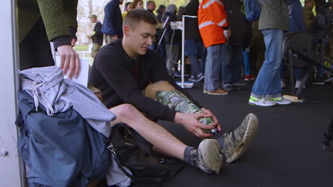 A-Man-Puts-On-A-Prosthetic-Leg-Before-An-Athletic-Event