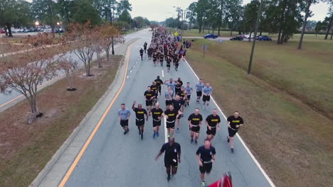 Aerial-Over-Us-Army-Recruits-Jogging-Down-A-Road-During-Basic-Training