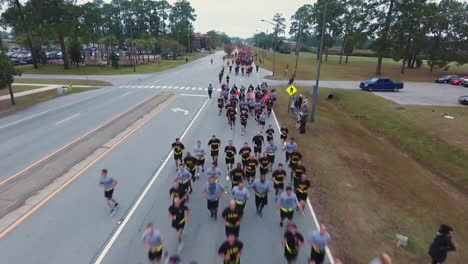 Aerial-Over-Us-Army-Recruits-Jogging-Down-A-Road-During-Basic-Training-1