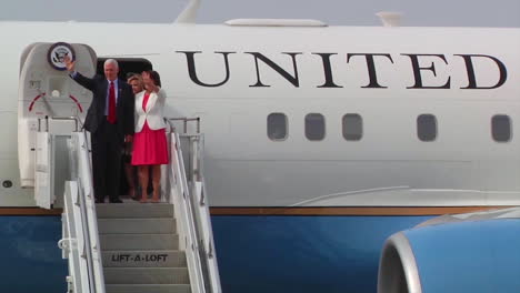 Vice-President-Mike-Pence-Emerges-From-Air-Force-Two-With-His-Wife-And-Entourage