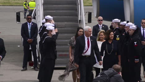 Vice-President-Mike-Pence-Emerges-From-Air-Force-Two-With-His-Wife-And-Entourage-2