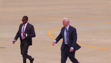 Vice-President-Mike-Pence-Walks-Across-An-Airport-Tarmac-Waving-At-His-Followers
