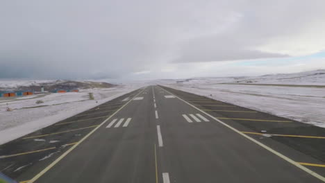 Pov-Of-A-Plane-Coming-In-For-A-Landing-On-An-Icy-Runway-In-The-Arctic