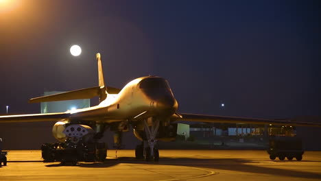 Time-Lapse-Of-The-Moon-Rising-Behind-A-B1-Bomber-On-The-Runway-At-Night