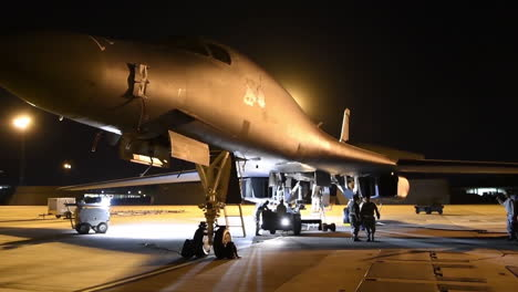 American-B1B-Nuclear-Bombers-Sit-On-The-Runway-At-An-Airbase-At-Night