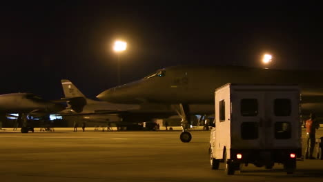 American-B1B-Nuclear-Bombers-Taxi-On-The-Runway-At-An-Airbase-At-Night