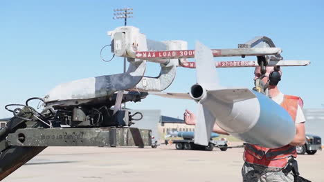 Bombs-Are-Loaded-Onto-An-American-B1B-Bomber-At-An-Air-Base-In-Advance-Of-A-Bombing-Mission