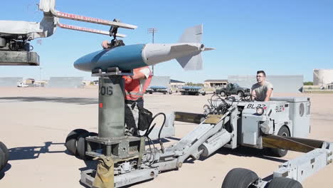 Bombs-Are-Loaded-Onto-An-American-B1B-Bomber-At-An-Air-Base-At-Night-In-Advance-Of-A-Bombing-Mission