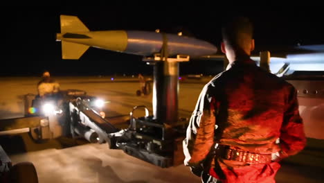 Bombs-Are-Loaded-Onto-An-American-B1B-Bomber-At-An-Air-Base-At-Night-In-Advance-Of-A-Bombing-Mission-2