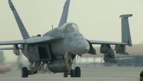A-United-States-Super-Hornet-Fighter-Jet-Taxis-On-A-Runway-At-A-Military-Base