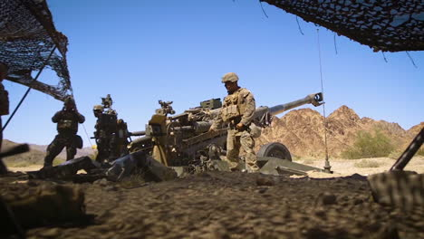 Soldiers-Fire-Artillery-In-Slow-Motion-During-A-Battle-On-The-Battlefield