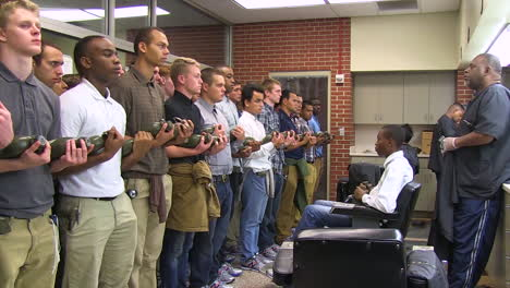 Time-Lapse-Of-New-Army-Recruits-Gettingtheir-Hair-Cut-And-Heads-Shaved-By-A-Barber-Before-Entering-Basic-Training