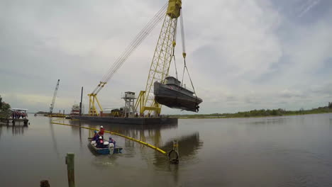Time-Lapse-Of-Coast-Guard-Marine-Removes-A-Lead-And-Asbestos-Infested-Old-Tugboat-Tutahaco-Friday-Near-Ormond-Beach-1