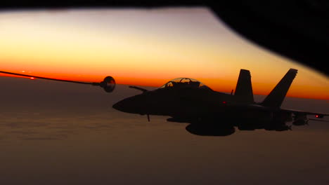 A-Midair-Jet-Refueling-Maneuver-Is-Conducted-By-The-Us-Air-Force-At-Sunset