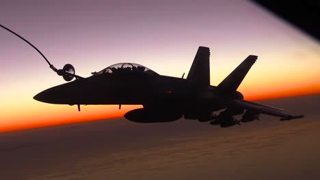 A-Midair-Jet-Refueling-Maneuver-Is-Conducted-By-The-Us-Air-Force-At-Sunset-1