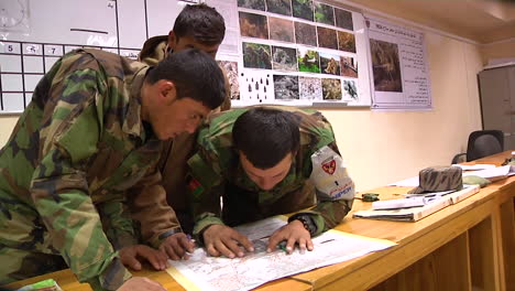 Soldiers-Study-Maps-At-Camp-Morehead-As-Part-Of-A-Training-Course-To-Join-The-Ranks-Of-Afghanistans-Special-Forces-Commando