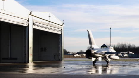 Jets-From-The-Royal-Danish-Air-Force-Are-Steered-Into-Hangars-At-_Iauliai-Air-Base-In-Lithuania
