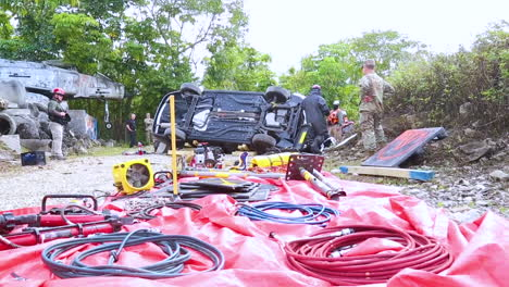 At-A-Fire-Rescue-Urban-Search-And-Rescue-Training-Site-Members-Of-The-Us-Army-Reserve-Break-Into-A-Crashed-Car-To-Save-A-Mannequin-Inside