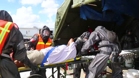 Volunteers-With-Simulated-Wounds-Are-Treated-By-Miamidade-Fire-Fighters-And-Us-Soldiers-In-A-Joint-Training-Exercise