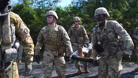 Us-Marines-Carry-A-Wounded-Man-To-A-Uh60-Black-Hawk-Medical-Helicopter-As-Part-Of-A-Training-Exercise