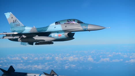 A-Usaf-Pilot-With-The-18Th-Aggressor-Squadron-Flies-His-F16-Fighting-Falcon-In-Blue-Skies-Over-Alaska