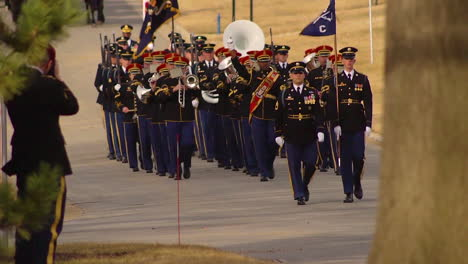 A-Military-Band-Leads-Off-A-Processional-Honoring-Us-Army-Sgt-1St-Class-Mihail-Golin-Before-He-Is-Laid-To-Rest-At-Arlington