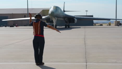 An-Aircraft-Marshal-Directs-A-Usaf-Plane-On-An-Air-Force-Base