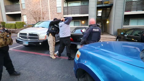 Ice-Officers-Handcuff-And-Arrest-An-Immigrant-Suspected-Of-Criminal-Activity