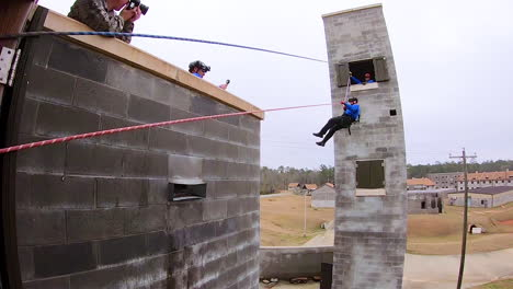 Members-Of-The-Mississippi-Task-Force-Search-And-Rescue-Team-Simulate-Being-Rescued-From-A-Collapsed-Structure