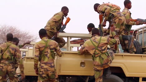 Nigerian-Soldiers-Assemble-Their-Rifles-And-Board-Trucks-To-Leave-For-Patrol