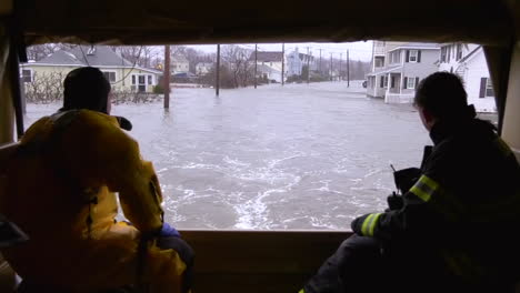 The-Massachusetts-National-Guard-And-Quincy-Firefighters-Drive-Through-A-Flooded-Area
