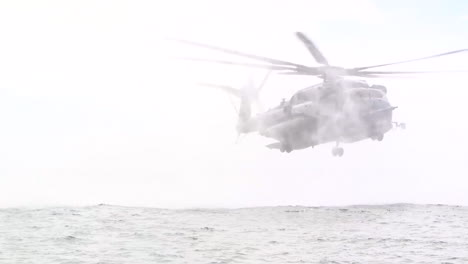 Us-Navy-Sailors-Fly-A-Helicopter-As-Part-Of-Helocast-Training