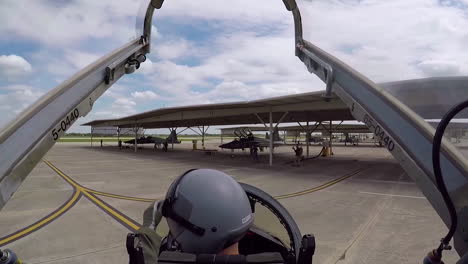 A-Camera-Stationed-Above-And-Behind-The-Pilot-In-The-Cockpit-Of-A-T38C-Shows-The-View-As-The-Aircraft-Taxiis-At-An-Air-Force-Base
