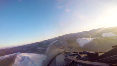Footage-Shot-From-The-Cockpit-Of-A-Usaf-Plane-As-It-Flies-Over-Wintry-Forests-And-Mountains