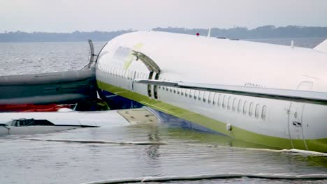 An-Airplane-that-Overran-the-Runway-At-the-Miami-International-Airport-Sits-In-Shallow-Water-With-Its-Emergency-Doors-Open-May-6th-2019