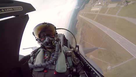 Cockpit-View-Of-A-F16-Fighter-Pilot-As-He-Makes-Sharp-Turns-Low-To-the-Ground-2019