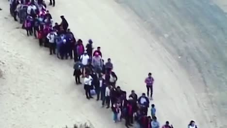 376-Migrants-Line-Up-To-Illegaly-Enter-Yuma-Az-2019
