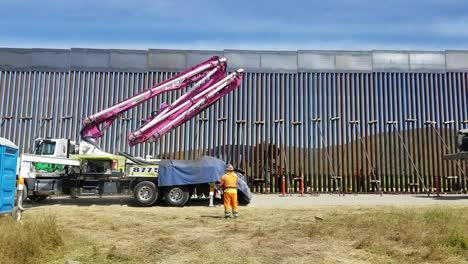 Us-Army-Corps-Of-Engineers-Contractors-Use-A-Concrete-Pump-Truck-To-Place-Concrete-For-the-Foundation-Of-the-San-Diego-Border-Wall
