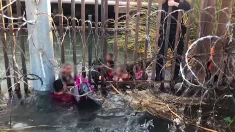 Smugglers-Pushed-A-Group-Of-Family-Units-through-A-Hole-In-the-Sanchez-Canal-Infrastructure-Which-Was-Underwater-2018