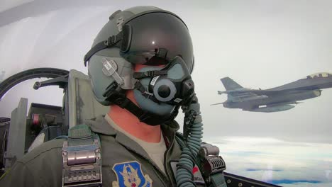 Cockpit-View-Of-A-Pilot-As-He-Makes-Visual-Communication-With-Another-Pilot-Mid-Flight-Red-Flag-191-Exercise-Nellis-Air-Force-Base-2019