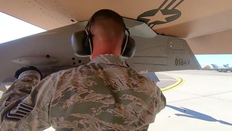 A-Man-Inspects-A-Military-Jet-At-Nellis-Air-Force-Base-Prior-To-the-Red-Flag-191-Exercise-2019