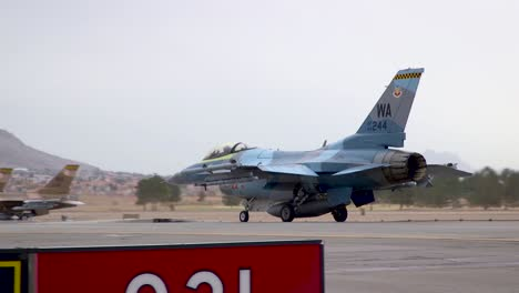 A-Blue-Military-Jet-Taxis-At-the-Nellis-Air-Force-Base-Prior-To-the-Red-Flag-191-Exercises-2019