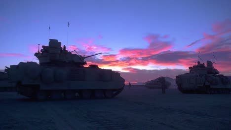 A-Company-Of-American-Military-Tanks-Out-In-the-Desert-At-Sunset-2019