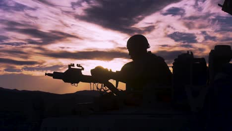 Silhouette-Of-A-Soldier-On-A-Machine-Gun-On-Top-Of-A-Tank-Against-A-Sunset-2019