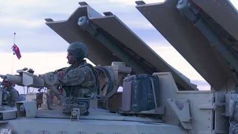 An-American-Soldier-Sits-In-A-M11150-Assault-Breacher-Vehicle-During-Training-2019