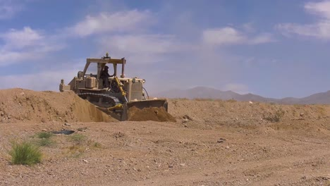 A-Bulldozer-Creates-A-Path-On-A-Battlefield-For-Tanks-During-Training-2019