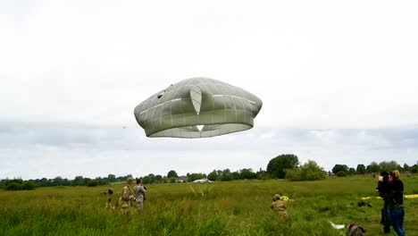 A-Paratrooper-As-He-Lands-In-A-Field-Near-Saintemereeglise-France-For-the-75th-Commemoration-Of-Dday-June-9th-2019