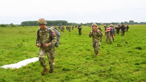 Paratroopers-Walk-Across-A-Field-Near-Saintemereeglise-France-After-Landing-For-the-75th-Commemoration-Of-Dday-June-9th-2019
