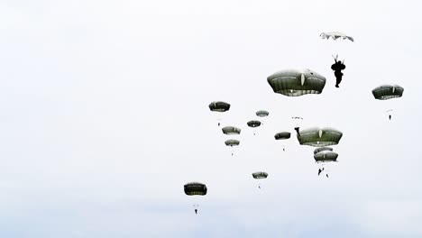 A-Bunch-Of-Paratroopers-As-they-Fall-From-the-Sky-Near-Saintemereeglise-France-For-the-75th-Commemoration-Of-Dday-June-9th-2019